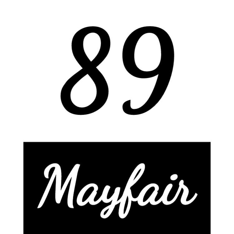 Black and white house number sign
