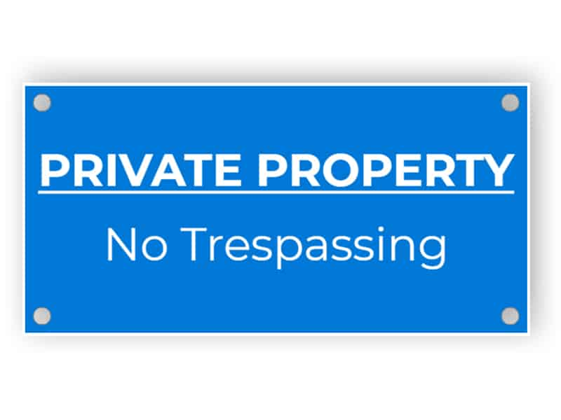Private property, no trespassing - blue sign