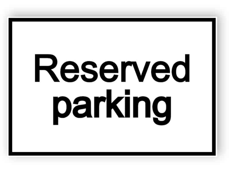 Reserved parking - white sign