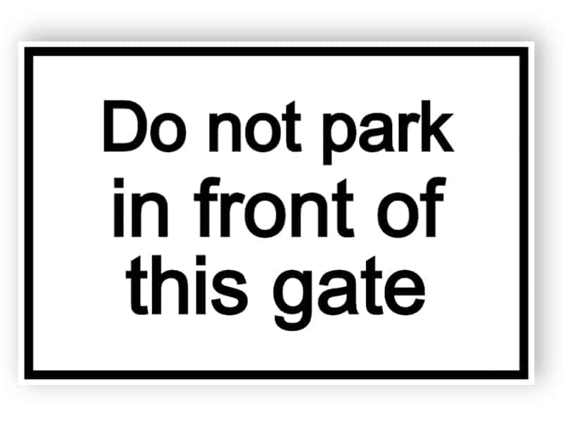 Do not park in front of this sign - white sign